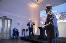 Kees Molenaar houdt een presentatie op het congres Goed Gebruik Hulpmiddelenzorg